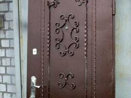 Изготовление кованных дверей решеток - фото 4
