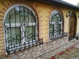 Изготовление кованных дверей решеток - фото 6