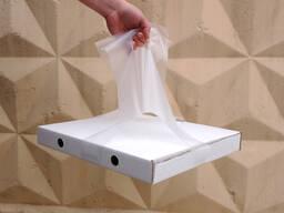 Пакеты - переноски коробок с пиццей.