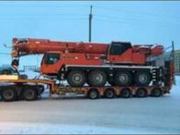 Услуги по перевозкам негабаритных грузов тралами.